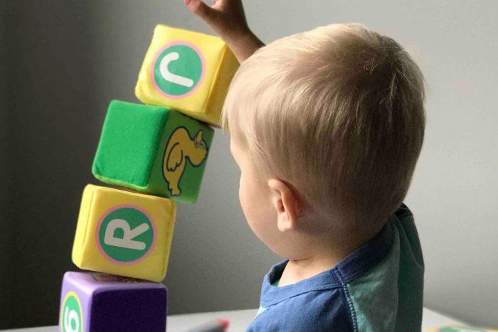 Toddler playing with blocks