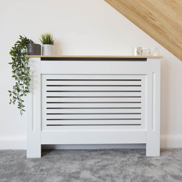 Radiator cover with wood vinyl wrap